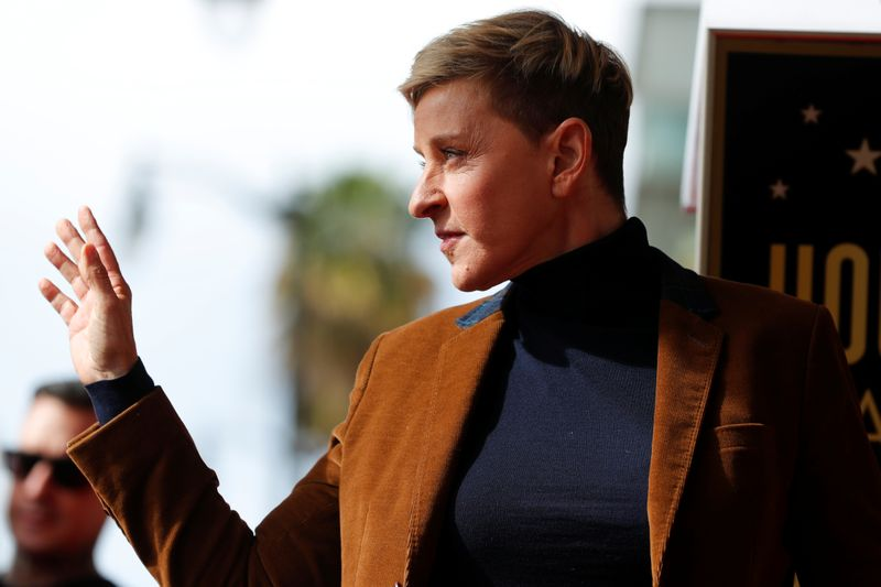 Comedian and talkshow host Ellen DeGeneres waves to fans as she attends a ceremony for singer Pink at the Hollywood Walk of Fame in Los Angeles