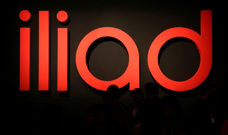 FILE PHOTO: Guests waits before French telecoms operator Iliad the media conference in Milan