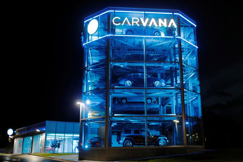 Vehicles are displayed at a Carvana dealership in Austin