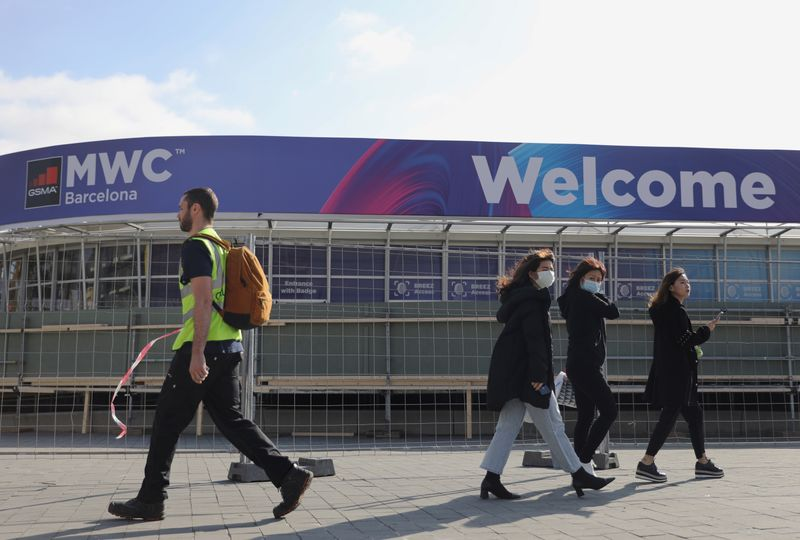 Employees pass by Fira de Barcelona after the Mobile World Congress (MWC) was cancelled in Barcelona