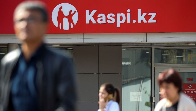 FILE PHOTO: The Kaspi Bank logo in seen at the bank's branch in Almaty