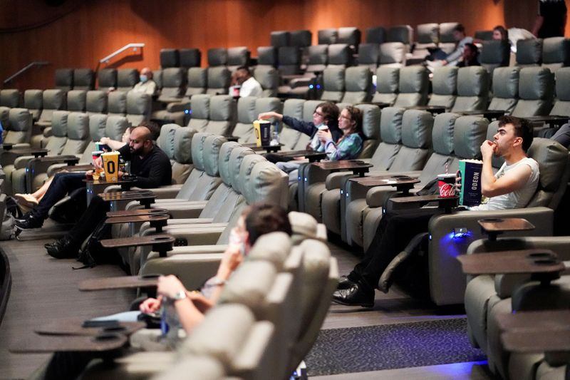 FILE PHOTO: People take their seats inside the Odeon Luxe Leicester Square cinema, on the opening day of the film