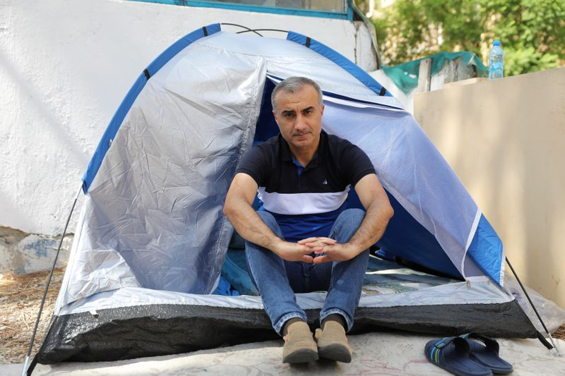 Omid Tootian, an Iranian musician, sits in a tent inside the UN buffer zone at Ledra Palace in Nicosia