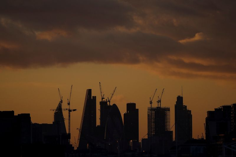 FILE PHOTO: Skyscrapers stand at sunset in the city of London's financial district in London