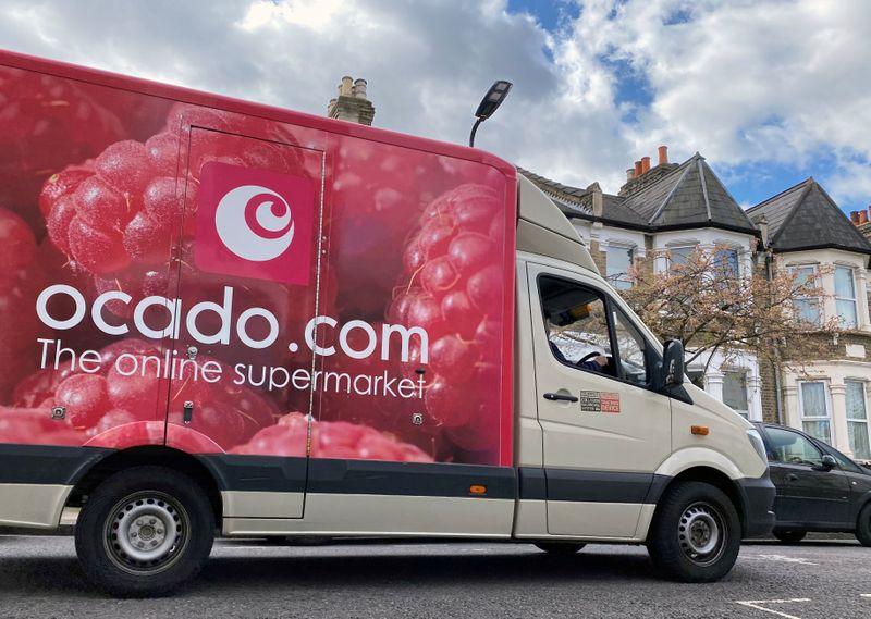 FILE PHOTO: An Ocado delivery van is driven along a road in Hackney, London, Britain