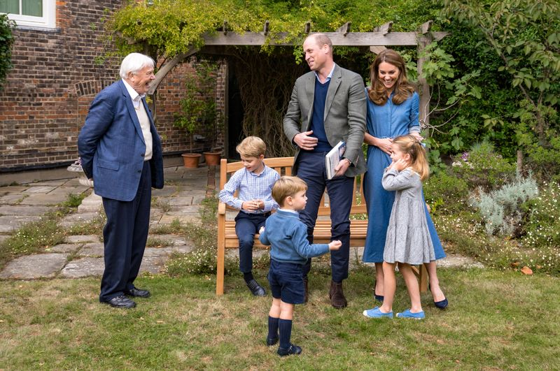 FILE PHOTO:  A handout photo released by Britain's Prince William and Cathrine, Duchess of Cambridge, Prince George, Princess Charlotte and Prince Louis with David Attenborough, in London