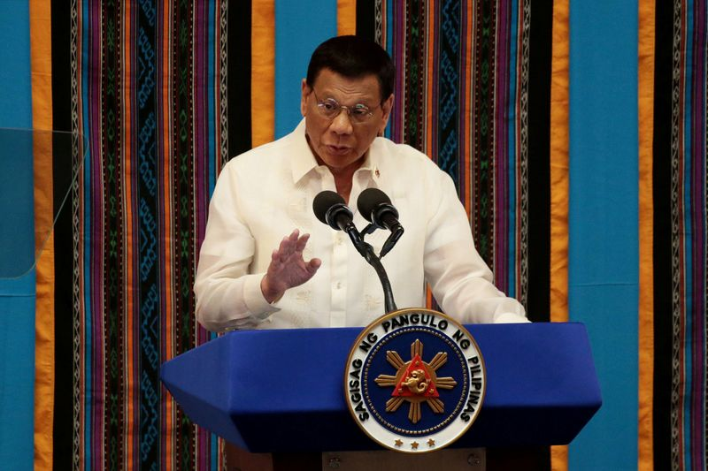 Philippine President Rodrigo Duterte gestures during his fourth State of the Nation Address at the Philippine Congress in Quezon City