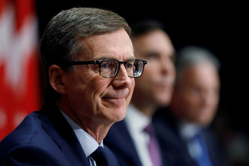 FILE PHOTO: Bank of Canada governor designate Tiff Macklem attends a news conference with Canada's Minister of Finance Bill Morneau and current Bank of Canada governor Stephen Poloz on Parliament Hill in Ottawa