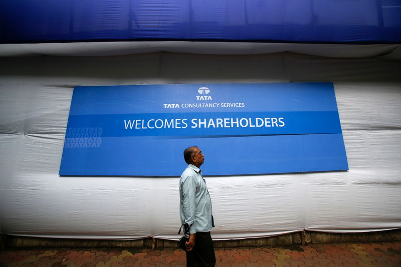 A shareholder arrives for the TCS annual general meeting in Mumbai