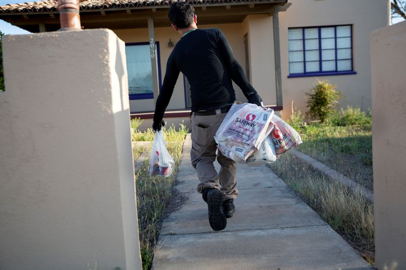 FILE PHOTO: Instacart employee Eric Cohn works amid the coronavirus outbreak