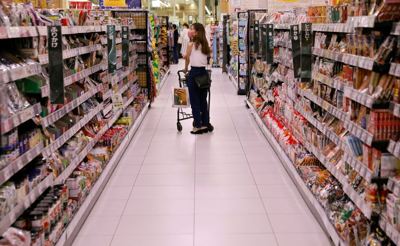 A shopper wearing a protective mask pushes a shopping cart at Japan's supermarket group Aeon's shopping mall as the mall reopens amid the coronavirus disease (COVID-19) outbreak in Chiba