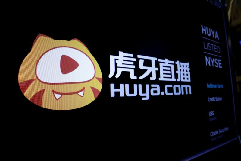 The Huya logo is shown on the NYSE boards ahead of the company's IPO at the New York Stock Exchange (NYSE) in New York