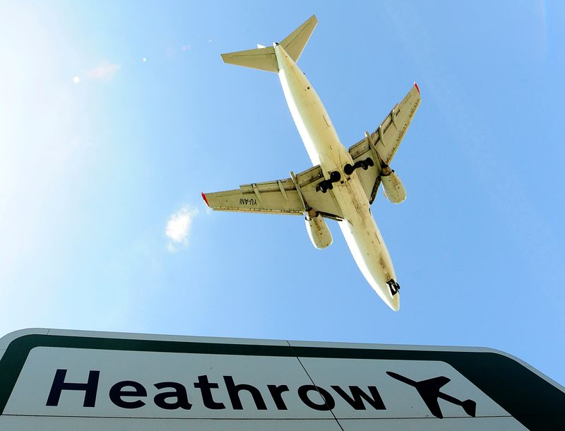 FILE PHOTO: FILE PHOTO: An aircraft comes in to land at Heathrow Airport in west London