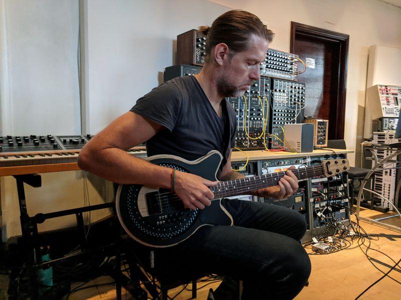 Radiohead guitarist Ed O'Brien plays a Circle Guitar in a studio in London