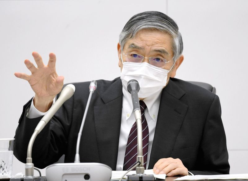 Bank of Japan Governor Haruhiko Kuroda wearing a protective face mask attends a news conference as the spread of the coronavirus disease continues in Tokyo