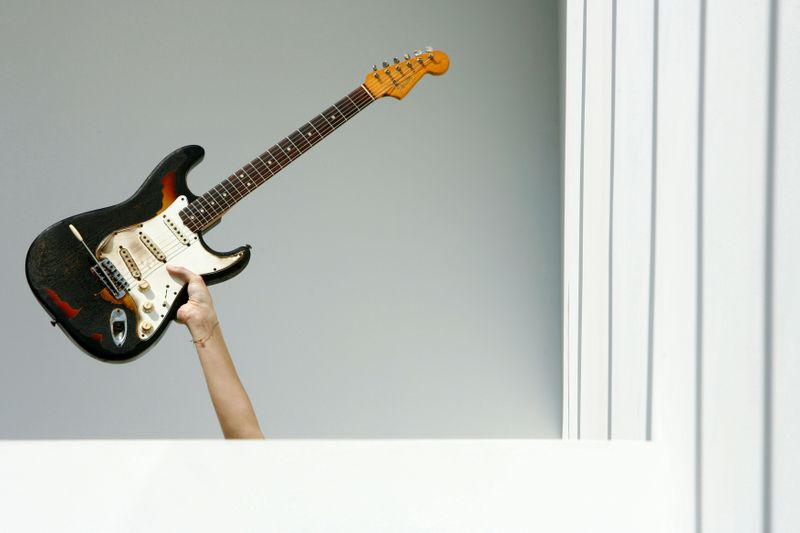 FILE PHOTO: A 1965 Fender Stratocaster guitar belonging to Jimi Hendrix is held up during a photocall at the Idea Generation Gallery in London