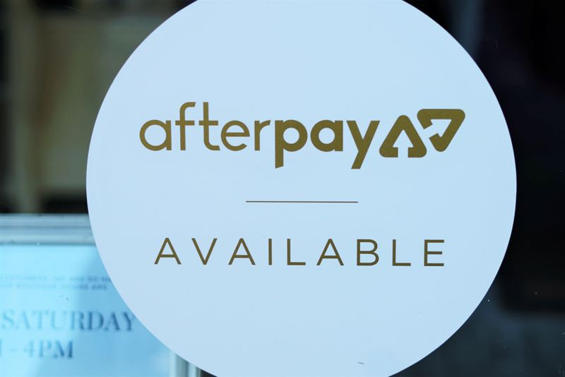 A logo for the company Afterpay is seen in a store window in Sydney