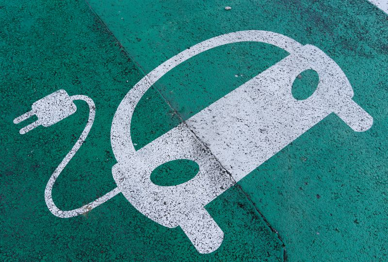 FILE PHOTO: A sign is pictured on an electric car charging station at the United Nations in Geneva