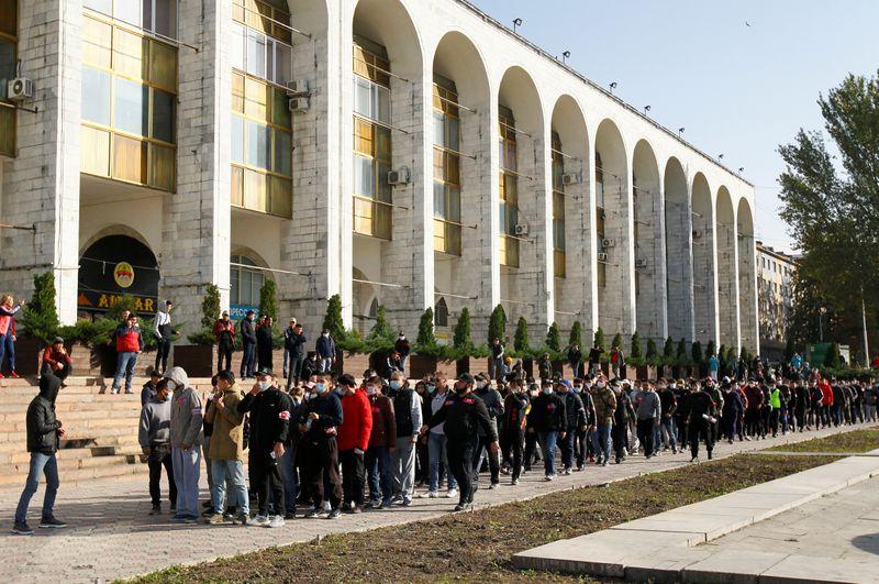 FILE PHOTO: Members of the voluntary people's patrol walk in Ala-Too Square in Bishkek