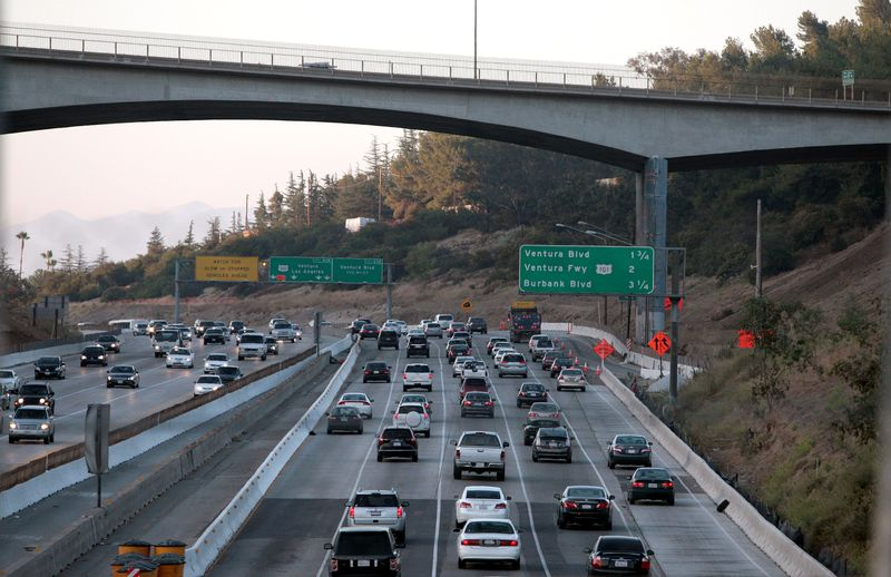 FILE PHOTO: Cars drive underneath the Mulholland Bridge on the 405 freeway in Los Angeles, California