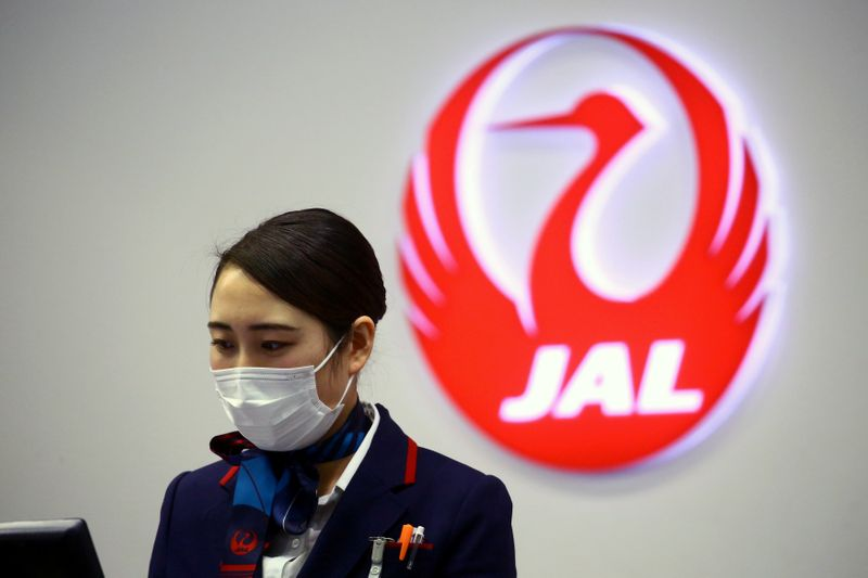 FILE PHOTO: An employee of Japan Airlines (JAL) is pictured at Kansai International Airport in Osaka