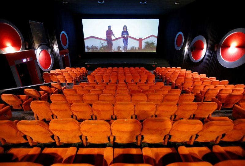 Empty chairs are seen during a movie time at City Gold cinema after its reopening in Ahmedabad