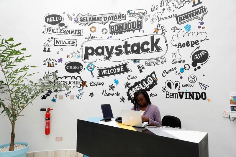 FILE PHOTO: A staff member works at the reception of the paystack online payment company in the government reserved area in Ikeja, in Lagos