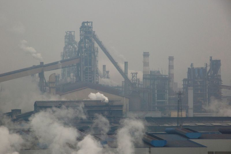 FILE PHOTO: Smoke and steam rise from a steel plant in Anyang