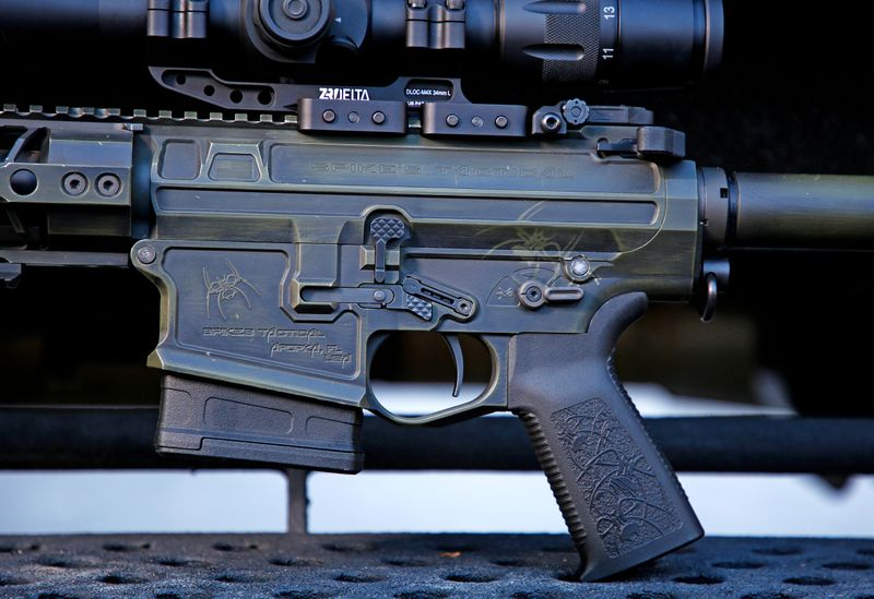 A detailed view of the trigger assembly, markings and finish of a fully assembled  rifle using the 6.5 Creedmoor cartridge is seen at Spike's Tactical LLC, a gunmaker in Apopka