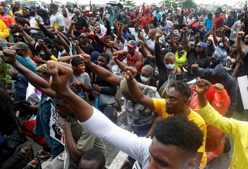 FILE PHOTO: Demonstrators gesture during a protest over alleged police brutality, in Lagos
