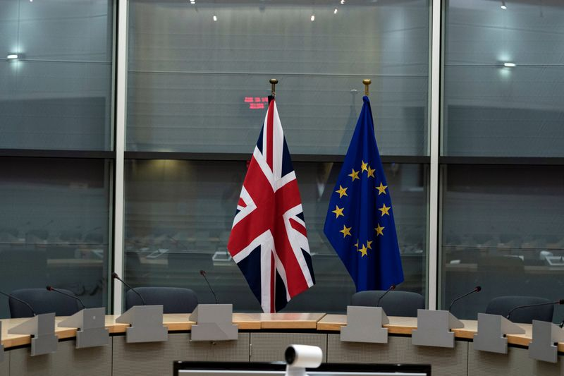 FILE PHOTO: British Union Jack and EU flags are pictured before the meeting with Britain's Brexit Secretary Barclay and EU's chief Brexit negotiator Barnier in Brussels