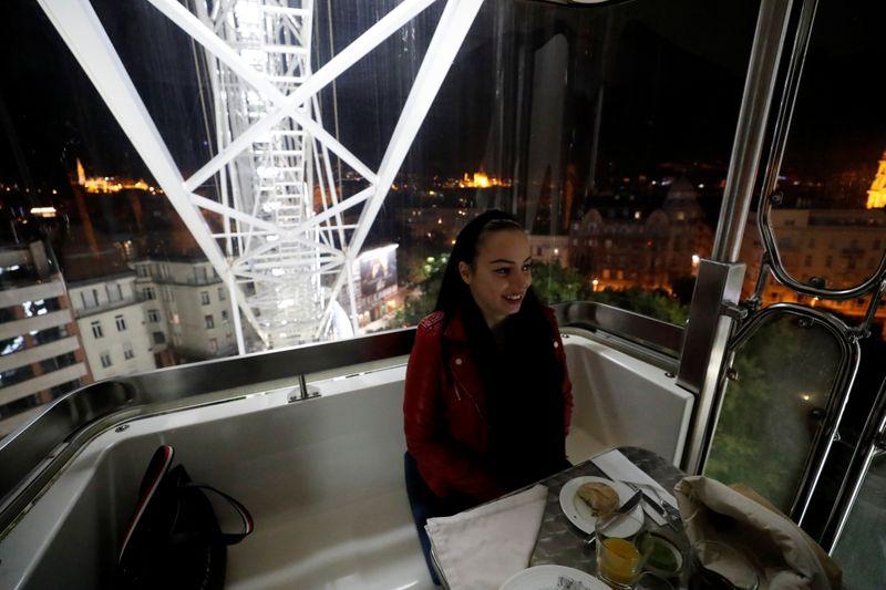 Hajnalka Lutor enjoys her meal as Michelin-starred restaurant Costes moves into the Budapest Eye ferris wheel during the coronavirus outbreak