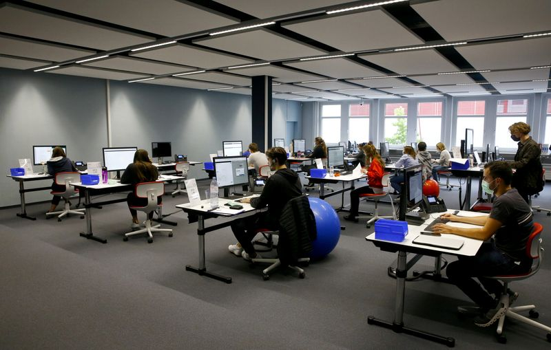 FILE PHOTO: Employees work at the center for contact tracing of the Canton of Zurich in Pfaeffikon