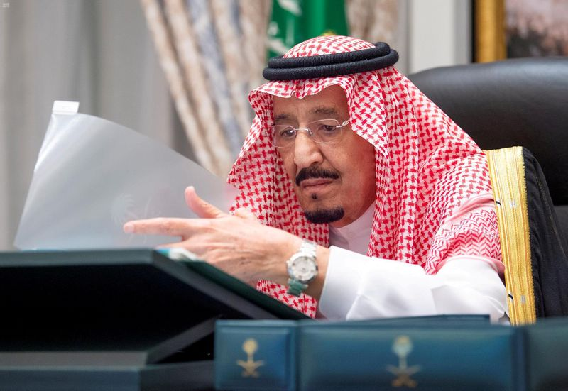FILE PHOTO: Saudi Arabia's King Salman bin Abdulaziz attends a virtual cabinet meeting in Neom
