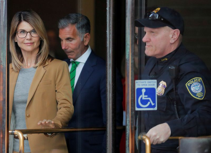 FILE PHOTO: Actor Lori Loughlin, and husband, fashion designer Mossimo Giannulli, facing charges in a nationwide college admissions cheating scheme, leave federal court in Boston