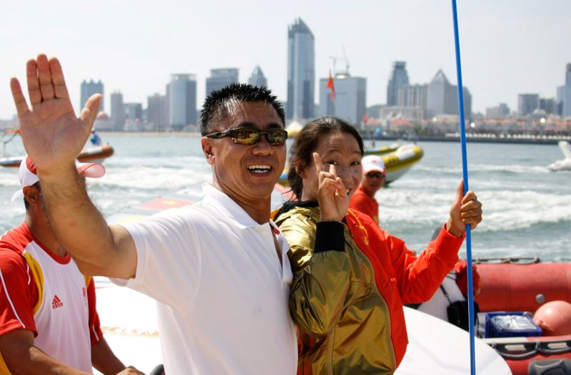 Vice President of Chinese Yachting Association Li Quanhai hugs Yin Jian of China, sailing in RS:X Women,  after she won gold at the Beijing 2008 Olympic Games in Qingdao