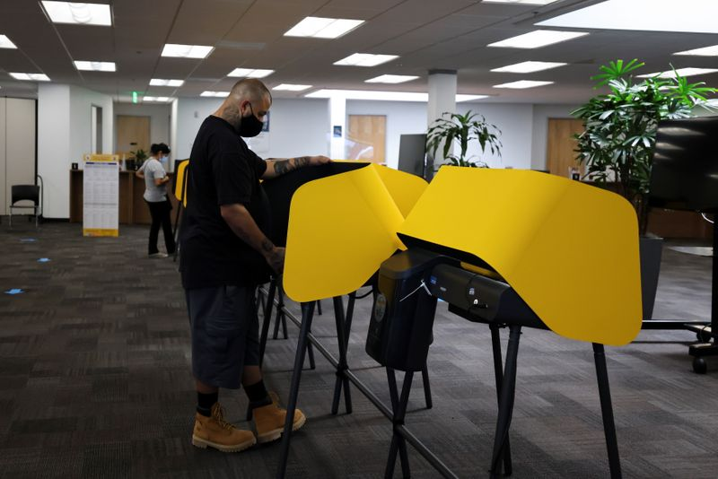 FILE PHOTO: Michael Gonzales, 35, votes at the Uber Hub polling station