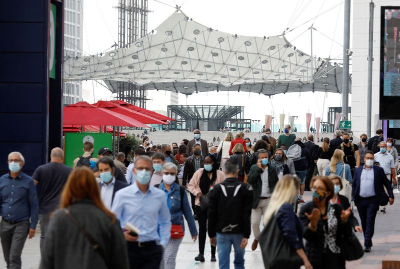 Masked people at financial and business district of La Defense