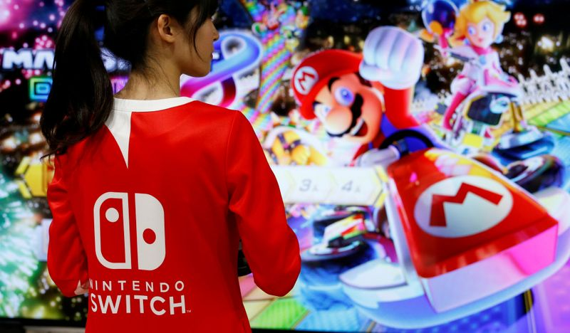 FILE PHOTO: An event employee of Nintendo attends the presentation ceremony for the Switch game console in 2017
