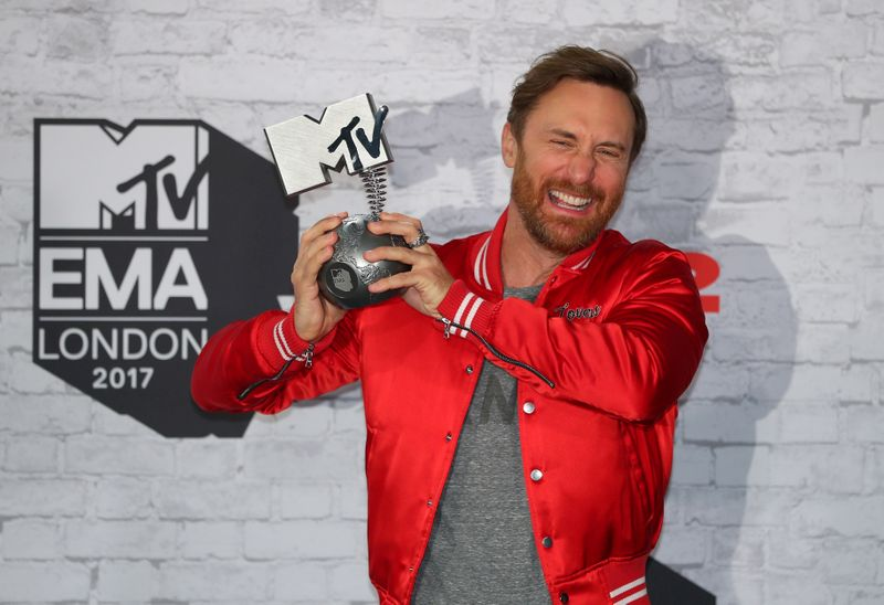 FILE PHOTO: French DJ David Guetta poses with his award during the 2017 MTV Europe Music Awards at Wembley Arena in London
