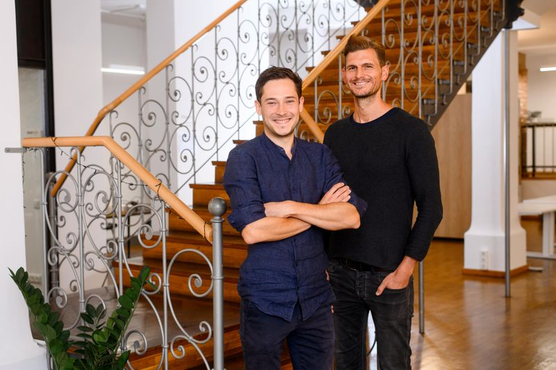 Limehome co-founders Lars Staebe (L) and Josef Vollmayr (R) pose for a photo in the company's headquarters in Munich