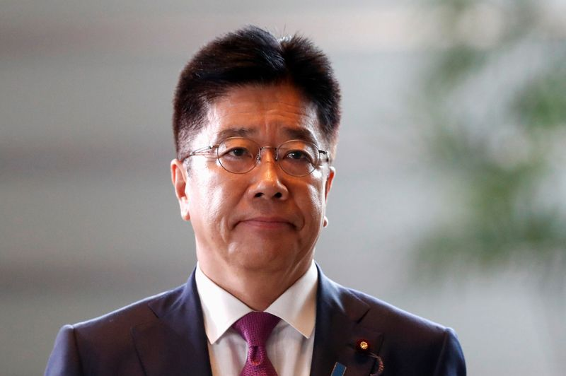 Japan's new Health, Labour and Welfare Minister Katsunobu Kato arrives at Prime Minister Shinzo Abe's official residence in Tokyo