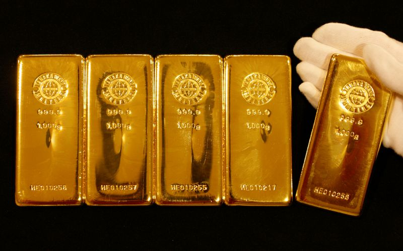 FILE PHOTO: Gold bars are displayed during a photo opportunity at the Ginza Tanaka store in Tokyo