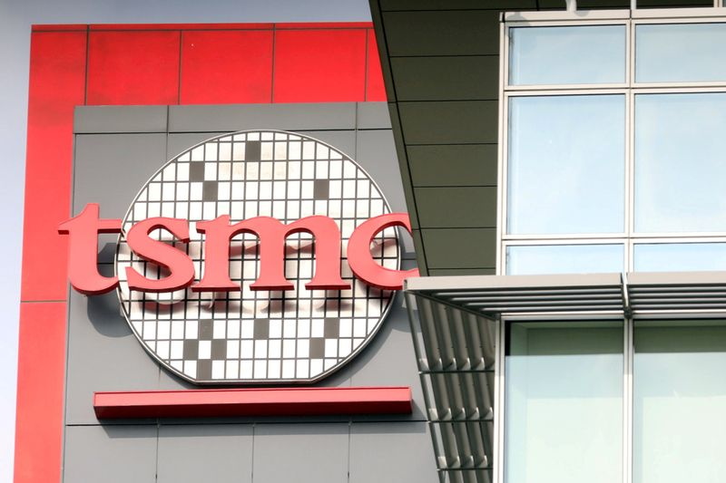 FILE PHOTO: A logo of Taiwan Semiconductor Manufacturing Co (TSMC) is seen at one of its office buildings in Tainan,