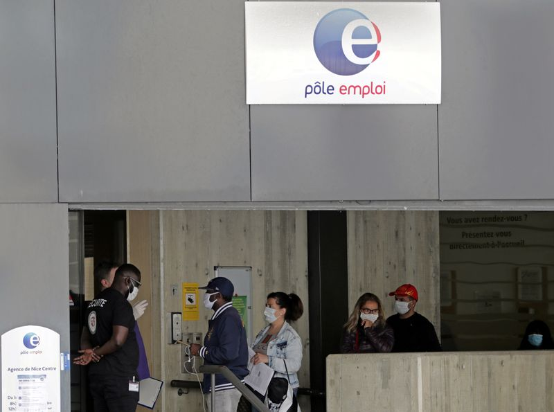 Job seekers, wearing protective face masks, visit a National Agency for Employment office in Nice