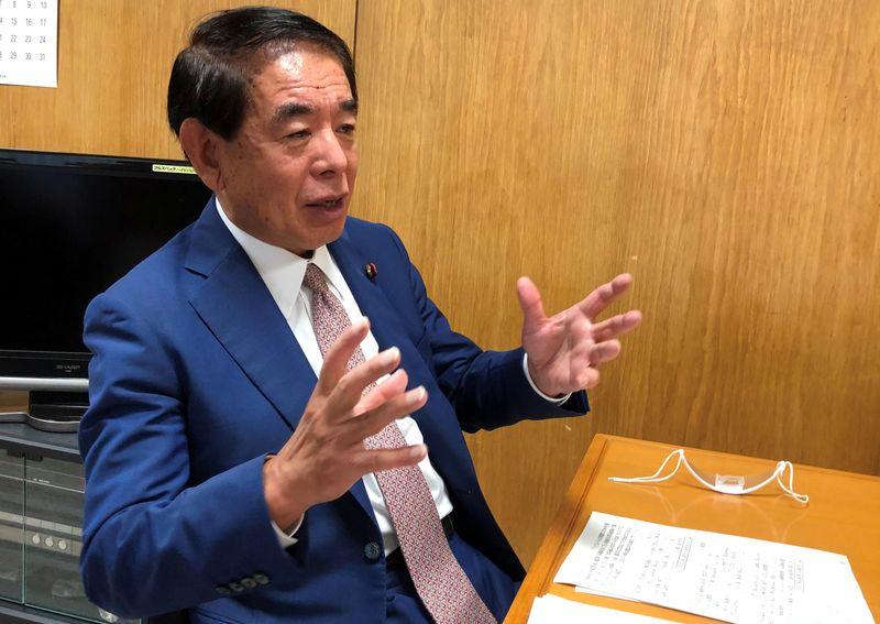 Hakubun Shimomura speaks during an interview with Reuters in Tokyo