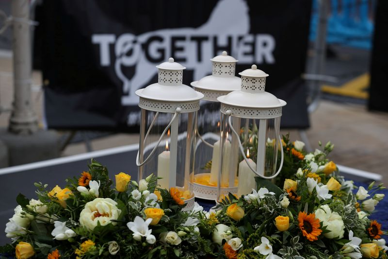 FILE PHOTO: A vigil for the victims of the Reading attack