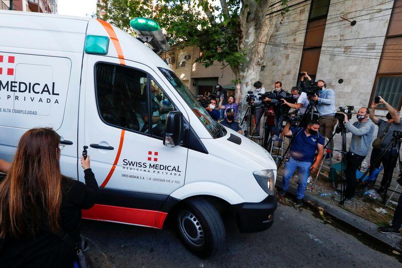 An ambulance carrying Diego Maradona leaves the clinic where Maradona underwent brain surgery, in Olivos