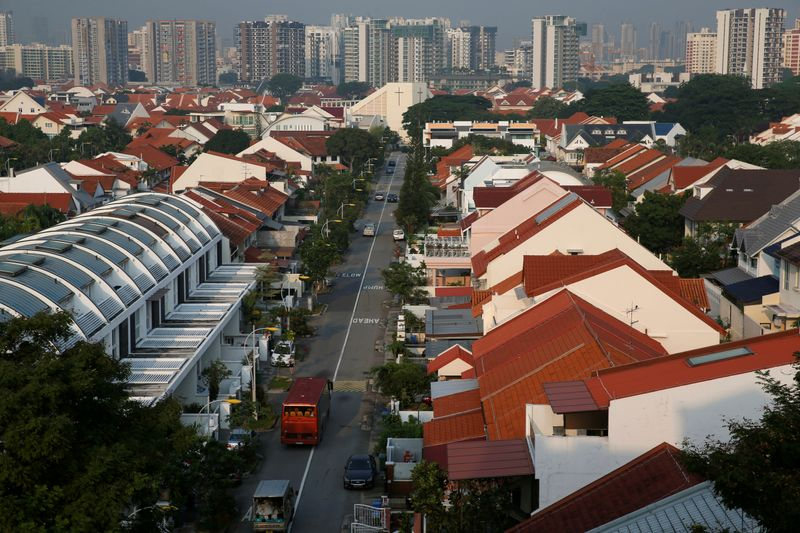 FILE PHOTO: Vehicles pass private landed residential properties at a neighbourhood in Singapore