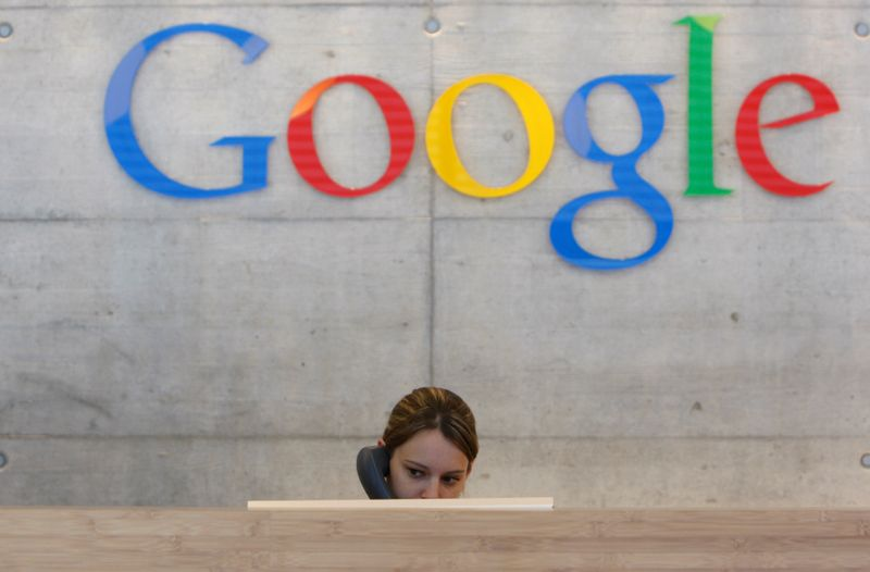 FILE PHOTO: An employee answers phone calls at the switchboard of the Google office in Zurich